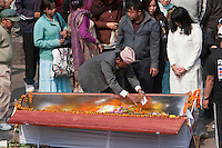 Pashupatinath, Kathmandu, Nepal.  Family Member Places Flowers and a Letter inside a Coffin of a Deceased.
