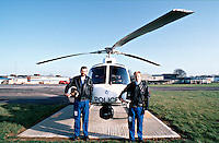 Police officers of the air support unit standing in front of the police helicopter.  ..© SHOUT. THIS PICTURE MUST ONLY BE USED TO ILLUSTRATE THE EMERGENCY SERVICES IN A POSITIVE MANNER. CONTACT JOHN CALLAN. Exact date unknown.john@shoutpictures.com.www.shoutpictures.com...