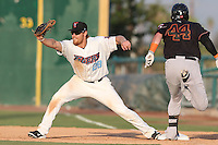 Dennis Raben #28 of the Inland Empire 66ers catches a throw to first base as Sean Buckley #44 of the Bakersfield Blaze hits the bag during a game at San Manuel Stadium on August 21, 2014 in San Bernardino, California. Inland Empire defeated Bakersfield, 3-1. (Larry Goren/Four Seam Images)
