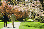 Walkers stroll in Washington Park Arboretum's gardens, which provide peace and tranquility in the city.  Seattle, Washington.