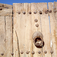 A traditional Moroccan street door with its iron studs and ancient doorknocker