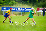 Kerry's Amy O'Sullivan slips past Aoife Griffin of Clare as she gets her effort away in the Munster Junior Camogie final