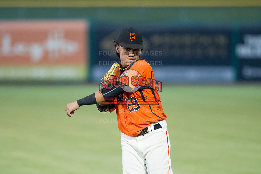 AZL Giants center fielder Ismael Munguia (29) warms up in the outfield prior to a game against the AZL Cubs on September 5, 2017 at Scottsdale Stadium in Scottsdale, Arizona. AZL Cubs defeated the AZL Giants 10-4 to take a 1-0 lead in the Arizona League Championship Series. (Zachary Lucy/Four Seam Images)