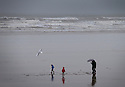 14/11/15<br /> <br /> A family brave wet and windy conditions on the beach at Westward Ho!, North Devon, as storms continue to batter the country.<br /> <br /> All Rights Reserved: F Stop Press Ltd. +44(0)1335 418365   +44 (0)7765 242650 www.fstoppress.com