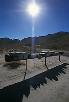 Row of mailboxes in the desert<br />