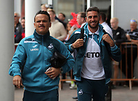 (L-R) Roque Mesa of Swansea City arrives prior to the game with team mate Angel Rangel during the Premier League match between Southampton and Swansea City at the St Mary's Stadium, Southampton, England, UK. Saturday 12 August 2017