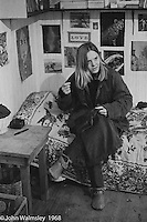 Doing some sewing in her bedroom, Summerhill school, Leiston, Suffolk, UK. 1968.