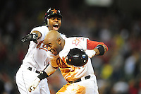 Apr. 30, 2011; Houston, TX, USA: Houston Astros batter (11) Jason Bourgeois is congratulated by teammate (21) Michael Bourn after hitting a walk off single in the ninth inning against the Milwaukee Brewers at Minute Maid Park. The Astros defeated the Brewers 2-1. Mandatory Credit: Mark J. Rebilas-