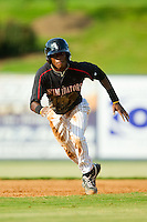 Tim Anderson (2) of the Kannapolis Intimidators takes off for third base against the Rome Braves at CMC-Northeast Stadium on August 25, 2013 in Kannapolis, North Carolina.  The Intimidators defeated the Braves 9-0.  (Brian Westerholt/Four Seam Images)