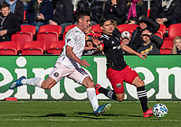 WASHINGTON, DC - MARCH 07: Ben Sweat #22 of Inter Miami chases Joseph Mora #28 of DC United during a game between Inter Miami CF and D.C. United at Audi Field on March 07, 2020 in Washington, DC.