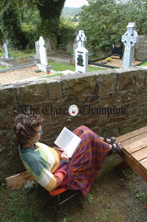 Local woman Ina Czech relaxes with a book at the East Clare Heritage Centre in Tuamgraney. Photograph by John Kelly.