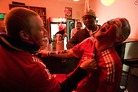 Denmark fans (left to right) Kristian Vincents and Dennis Eugstrop share a laugh after dancing to music at a bar just outside the Royal Bafokeng Stadium after the 2010 World Cup first round match between Denmark and Japan in Rustenberg, South Africa on Thursday, June 24, 2010.