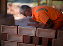 01/10/15<br /> <br /> A man checks and stacks some of the 18,000 bricks he is due to move today.<br /> <br /> ***Full story here:  http://www.fstoppress.com/articles/london-bricks/  ***<br /> <br /> Triathletes have recently coined the term 'brick workout' to describe their gruelling training regime when running, following tough sessions on their bicycles.<br /> <br /> But one group of workers have been using their very own 'brick workout' for decades, without the need for lycra, personal trainers or lightweight bicycles.<br /> <br /> But one group of workers have been using their very own 'brick workout' for decades, without the need for lycra, personal trainers or lightweight bicycles.<br /> <br /> These men, 21 on every shift, each pick-up, inspect, and re-stack 18,000 London Bricks every day.<br /> <br /> One brick weighs 2 kg – so each man lifts the equivalent of almost 40 tons every day at the brick works, near Peterborough, where 2.8 million bricks are made each week.<br /> <br /> All Rights Reserved: F Stop Press Ltd. +44(0)1335 418365   www.fstoppress.com.