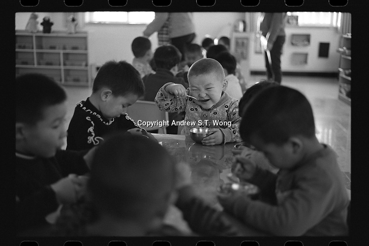 Jeminay County, Xinjiang Uygur Autonomous Region, China - Students eat lunch at a nursery, October 2019.