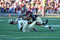 Texas State cornerback David Mims II (22) brings down Idaho wide receiver Deon Watson (83) during first half of an NCAA Football game, Saturday, October 04, 2014 in San Marcos, Tex. Texas State leads Idaho 21-3 at the halftime(Mo Khursheed/TFV Media via AP Images)