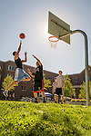Students playing basketball at the University of Portland.