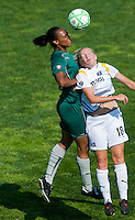 Los Angeles Sol midfielder Katie Larkin (18) goes up for a header against St Louis Athletica defender Kia McNeill (6) during a WPS match at Hermann Stadium, in St. Louis, MO, April 25 2009.  Athletica and Sol tied the match.