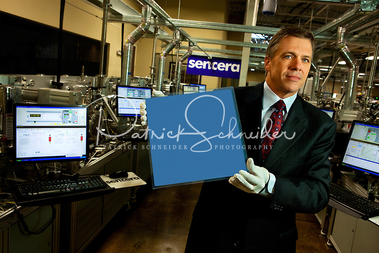 "Sencera chief operating officer Britt Weaver holds a photovoltaic solar cell manufactured in Sencer's Charlotte, NC, high-tech manufacturing operations. Sencera International Corp., manufactures thin film silicon-based photovoltaic modules (thin-film silicon solar cells and solar panels). The privately held company produces thin film photovoltaic modules and uses its proprietary ""Viper Plasma Enhanced Chemical Vapor Deposition Platform"" to create amorphous silicon thin film modules for solar technologies. Sencera's primary business development offices and operations are based in Charlotte, North Carolina. California-based Quercus Trust is the lead investor in the company."