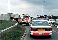 Road traffic accident involving a lorry that toppled over as it approached a roundabout. In the foreground is the traffic police car dealing with the incident...© SHOUT. THIS PICTURE MUST ONLY BE USED TO ILLUSTRATE THE EMERGENCY SERVICES IN A POSITIVE MANNER. CONTACT JOHN CALLAN. Exact date unknown.john@shoutpictures.com.www.shoutpictures.com...