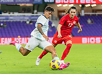 ORLANDO, FL - FEBRUARY 21: Lorena Benitez #16 of Argentina crosses the ball past Jessie Fleming #17 of Canada during a game between Canada and Argentina at Exploria Stadium on February 21, 2021 in Orlando, Florida.