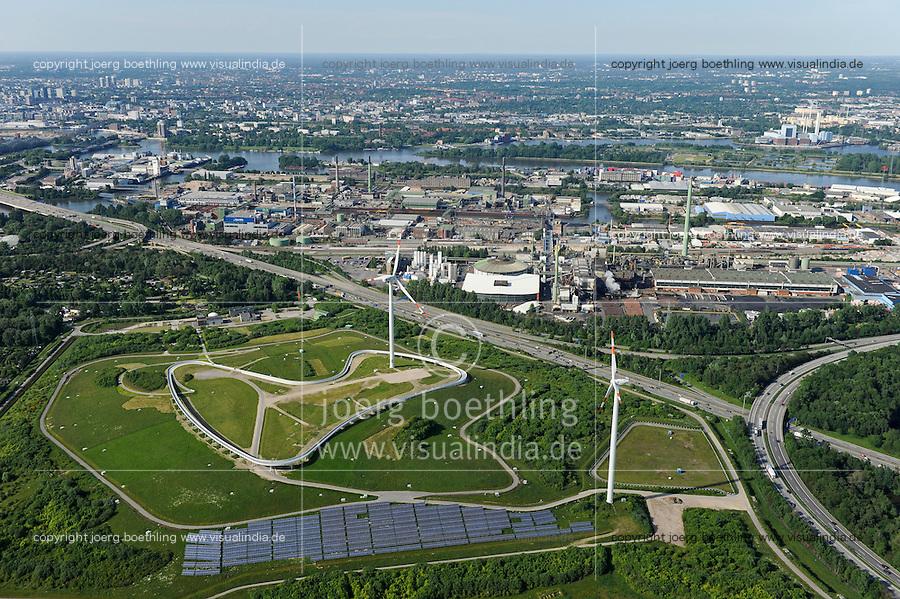 DEUTSCHLAND Hamburg, ehemaliger Muellberg Georgswerder, IBA Projekt regenerativer Energieberg. Windenergie Sonnenenergie und Deponiegase versorgen ueber 2000 Haushalte der Elbinsel mit Strom. Der Energieberg ist auch Aussichtspunkt und oeffentlich zugaenglich , kleine Windturbine Repower, grosse Windturbine REpower 3.4 MW Windturbine und Photovoltaik Anlage 700 Kwp werden vom kommunalen Energieversorger Hamburg Energie betrieben<br /> /<br /> GERMANY Hamburg , IBA Project Energy Mountain Georgswerder, solar und wind energy on a former garbage dumping site , small and large wind turbine REpower and solar field of company Hamburg energy