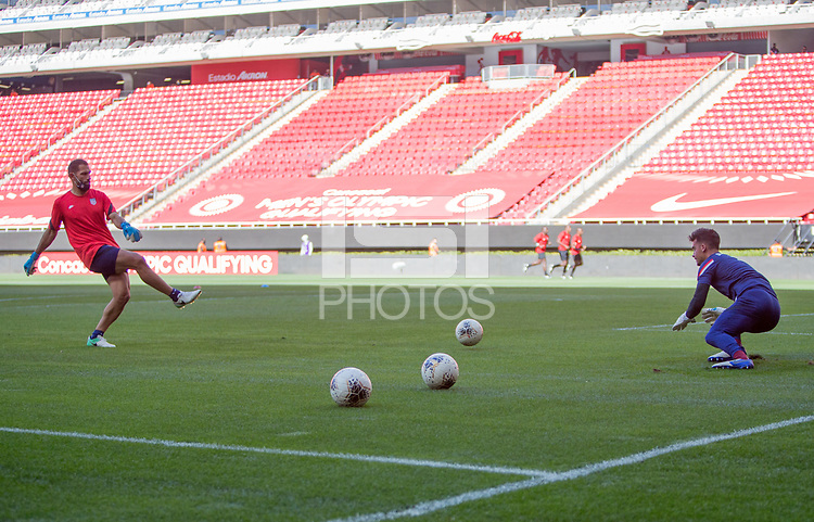ZAPOPAN, MEXICO - MARCH 21: Rob Vartughian assistant coach of the United States warming up JT Marcinkowski #1 before a game between Dominican Republic and USMNT U-23 at Estadio Akron on March 21, 2021 in Zapopan, Mexico.