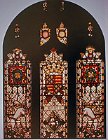 Stained glass windows on stairs to Committee floor. Designed by Augustus Pugin.