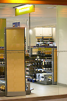 View through the shop window to one of the Systembolaget wine and spirit retail stores with shelves of bottles of sparkling mousserande wine Stockholm, Sweden, Sverige, Europe