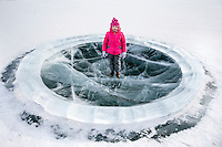 A young girl stands in a playground made entirely of ice in Yakutsk, the coldest city on earth and the only major settlement on earth built on permafrost.