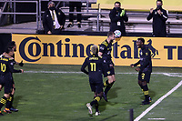 COLUMBUS, OH - DECEMBER 12: Derrick Etienne Jr #22 of the Columbus Crew celebrates scoring the second goal of the game with teammates during a game between Seattle Sounders FC and Columbus Crew at MAPFRE Stadium on December 12, 2020 in Columbus, Ohio.