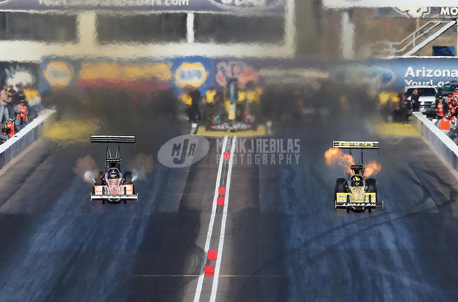 Feb. 24, 2013; Chandler, AZ, USA; NHRA top fuel dragster driver Morgan Lucas (right) pops the blower alongside Clay Millican during the Arizona Nationals at Firebird International Raceway. Mandatory Credit: Mark J. Rebilas-