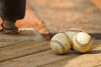 Baseballs sit in the Wake Forest Demon Deacons dugout during the game against the North Carolina State Wolfpack at Doak Field at Dail Park on March 17, 2012 in Raleigh, North Carolina.  The Wolfpack defeated the Demon Deacons 6-2.  (Brian Westerholt/Four Seam Images)