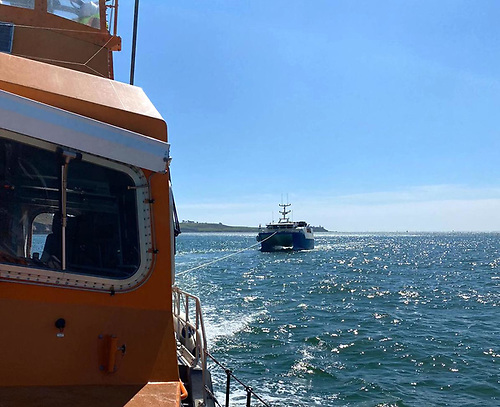 Ballycotton RNLI all-weather Trent class lifeboat the Austin Lidbury tows home the broken down fishing vessel
