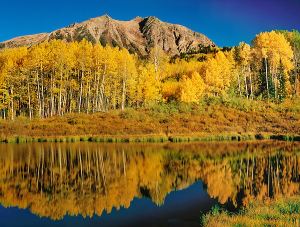 The Elk Mountains and pond along  Kebler Pass, Crested Butte, Colorado, John offers autumn photo tours throughout Colorado. .  John leads private photo tours throughout Colorado. Year-round Colorado photo tours.