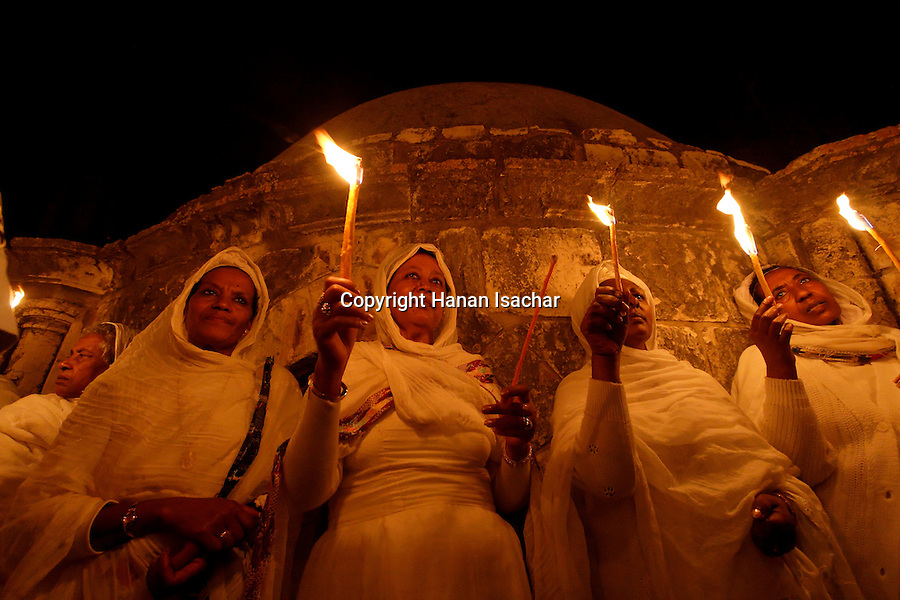 Israel, Jerusalem Old City, Ethiopian Orthodox pilgrims at Deir es Sultan by the dome of St. Helena Chapel at the Church of the Holy Sepulchre on Holy Saturday, Easter, 2006<br />