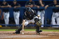 Wake Forest Demon Deacons catcher Logan Harvey (15) picks up the baseball during the game against the Florida Gators in Game Three of the Gainesville Super Regional of the 2017 College World Series at Alfred McKethan Stadium at Perry Field on June 12, 2017 in Gainesville, Florida. The Gators defeated the Demon Deacons 3-0 to advance to the College World Series in Omaha, Nebraska. (Brian Westerholt/Four Seam Images)