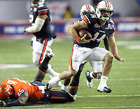 ATLANTA, GA - DECEMBER 31: Barrett Trotter #14 of the Auburn Tigers handles the ball during the 2011 Chick Fil-A Bowl against the Virginia Cavaliers at the Georgia Dome on December 31, 2011 in Atlanta, Georgia. Auburn defeated Virginia 43-24. (Photo by Andrew Shurtleff/Getty Images) *** Local Caption *** Barrett Trotter
