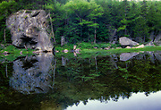 Reflection of boulders in Dismal Pool in Crawford Notch State Park in the New Hampshire White Mountains.