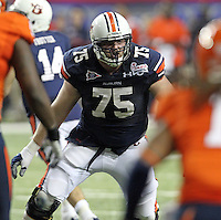 ATLANTA, GA - DECEMBER 31: Brandon Mosley #75 of the Auburn Tigers moves on the line during the 2011 Chick Fil-A Bowl against the Virginia Cavaliers at the Georgia Dome on December 31, 2011 in Atlanta, Georgia. Auburn defeated Virginia 43-24. (Photo by Andrew Shurtleff/Getty Images) *** Local Caption *** Brandon Mosley