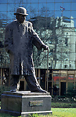 Belgrade, Serbia, Yugoslavia. Sculpture of Branislav Nusic with a walking stick and bowler hat by Zoran Ivanovic; Trg Republike.