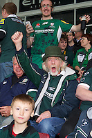130712 Copyright onEdition 2012 ©.Free for editorial use image, please credit: onEdition..London Irish fans cheer their team at The Stoop, Twickenham in the first round of The J.P. Morgan Asset Management Premiership Rugby 7s Series...The J.P. Morgan Asset Management Premiership Rugby 7s Series kicked off again for the third season on Friday 13th July at The Stoop, Twickenham with Pool B being played at Edgeley Park, Stockport on Friday, 20th July, Pool C at Kingsholm Gloucester on Thursday, 26th July and the Final being played at The Recreation Ground, Bath on Friday 3rd August. The innovative tournament, which involves all 12 Premiership Rugby clubs, offers a fantastic platform for some of the country's finest young athletes to be exposed to the excitement, pressures and skills required to compete at an elite level...The 12 Premiership Rugby clubs are divided into three groups for the tournament, with the winner and runner up of each regional event going through to the Final. There are six games each evening, with each match consisting of two 7 minute halves with a 2 minute break at half time...For additional images please go to: http://www.w-w-i.com/jp_morgan_premiership_sevens/..For press contacts contact: Beth Begg at brandRapport on D: +44 (0)20 7932 5813 M: +44 (0)7900 88231 E: BBegg@brand-rapport.com..If you require a higher resolution image or you have any other onEdition photographic enquiries, please contact onEdition on 0845 900 2 900 or email info@onEdition.com.This image is copyright the onEdition 2012©..This image has been supplied by onEdition and must be credited onEdition. The author is asserting his full Moral rights in relation to the publication of this image. Rights for onward transmission of any image or file is not granted or implied. Changing or deleting Copyright information is illegal as specified in the Copyright, Design and Patents Act 1988. If you are in any way unsure of your right to publish this image please contact onEdition on 0845