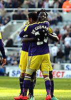 Pictured: Wilfried Bony of Swansea celebrating his goal with team mate Jonathan de Guzman from the penalty spot after Marvin Emnes was brought dowin in the box in stoppage time. Saturday 19 April 2014<br /> Re: Barclay's Premier League, Newcastle United v Swansea City FC at St James Park, Newcastle, UK.