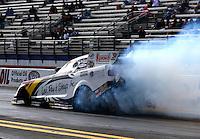 Feb 7, 2014; Pomona, CA, USA; NHRA funny car driver Tim Wilkerson during qualifying for the Winternationals at Auto Club Raceway at Pomona. Mandatory Credit: Mark J. Rebilas-