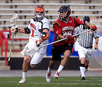 Mike Thompson (17) of Virginia is defended by Jesse Bernhardt (36) of Maryland during the ACC men's lacrosse tournament finals in College Park, MD.  Virginia defeated Maryland, 10-6.