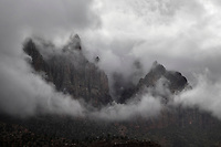 A passing rain storm brings clouds and fog to Zion Canyon at Zion National Park, Utah