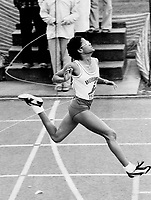 Woburn's Nicole Ali breaks the tape in midget girls' 100 metre