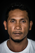 31 year old Tuna fisherman, Rio Asuque poses for a portrait at the Casa, the Tuna buying house in Puerto Princesa, Palawan in the Philippines. <br /> Photo: Sanjit Das/Panos for Greenpeace