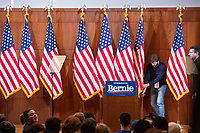 """Flags stand on the stage before Democratic presidential candidate and Vermont senator Bernie Sanders delivers his response to President Donald Trump's State of the Union address earlier that night at The Currier Museum of Art in Manchester, New Hampshire, on Tue., Feb. 4, 2020. Sanders' speech began, """"Tonight, we just listened to Donald Trump's third, and what I believe will be his very last, State of the Union Address."""""""