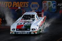 Jan 25, 2009; Chandler, AZ, USA; NHRA funny car driver John Force does a burnout during testing at the National Time Trials at Firebird International Raceway. Mandatory Credit: Mark J. Rebilas-