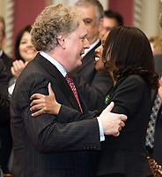 Quebec City, April 18, 2007 - Prime minister Jean Charest hugs Yolande James, his new immigration and cultural communities at the Red room of the National assembly in Quebec City April 18, 2007. James is the first member of a visible minority to be named minister in Quebec.<br /> <br /> PHOTO :  Francis Vachon - Agence Quebec Presse